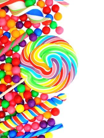 paletas de caramelo: Caramelo colorido esquina frontera con piruletas y chicles Foto de archivo