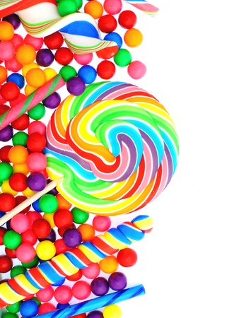 Colorful candy corner border with lollipops and gumballs photo