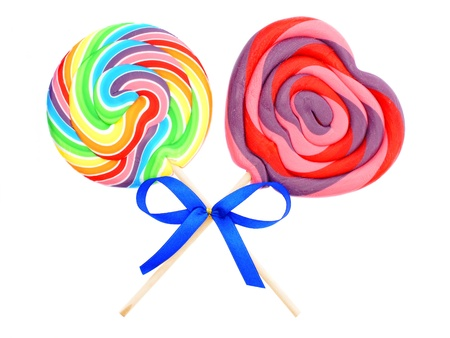 Two colorful lollipops with bow isolated on white photo
