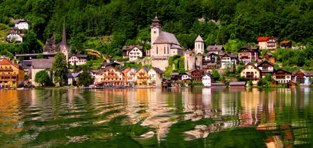 austrian village: Panaramic view of the village of Hallstatt, Austria with lake reflections  Stock Photo