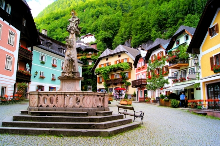 Colorful town square in the village of Hallstatt, Austria photo