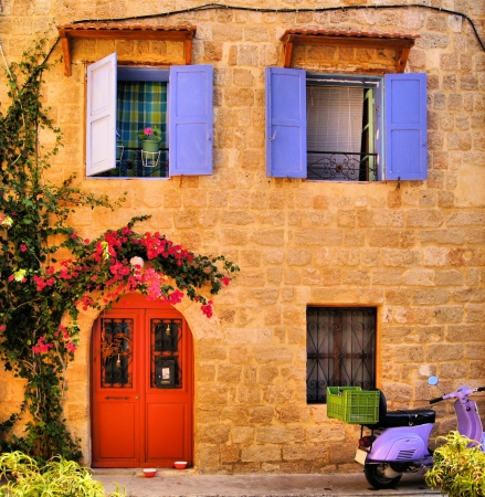 Facade of a traditional stone house in the Old Town of Rhodes, Greece photo