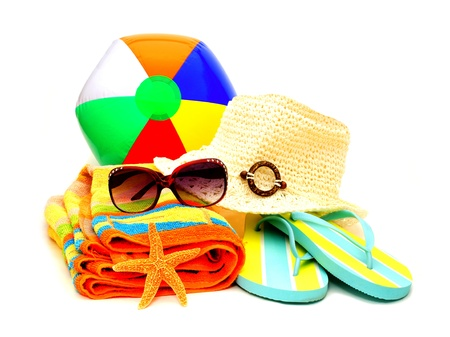 flipflops: Collection of beach items - towel, flip-flops, sunglasses, hat and beach ball isolated on white