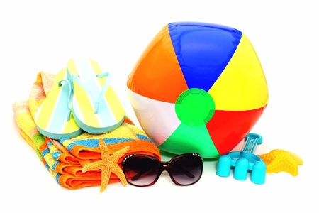 beach toys: Collection of beach items - towel, flip-flops, sunglasses, beach ball and toys isolated on white