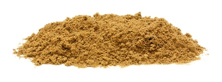 白い背景に分離した砂の山 写真素材