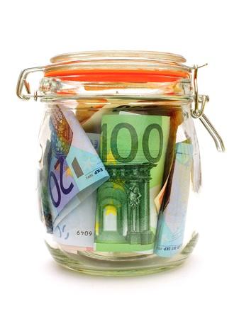 20 euro: Money jar containing Euro notes isolated on white