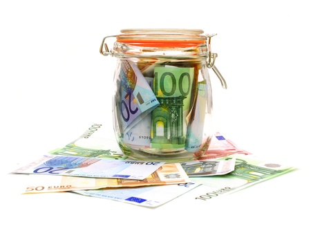 20 euro: Money jar containing Euro currency with scattered notes over white