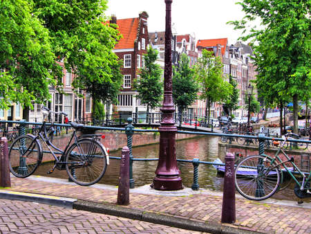Bicycles along a bridge over the canals of Amsterdam, Netherlands photo