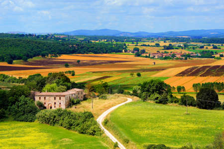 View over the colorful fields of Tuscany with traditional farm house, Italy Stock Photo - 20862977