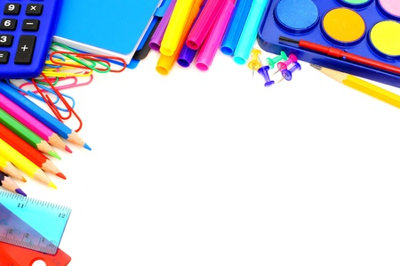 Colorful border of school supplies over a white background photo