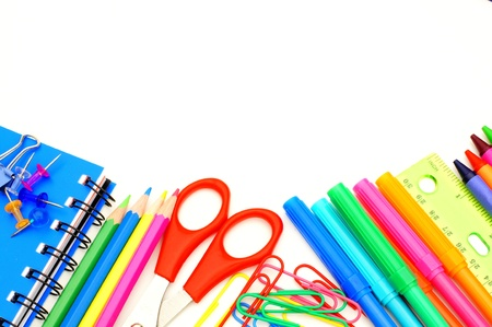 objects: Colorful border of school supplies over a white background Stock Photo