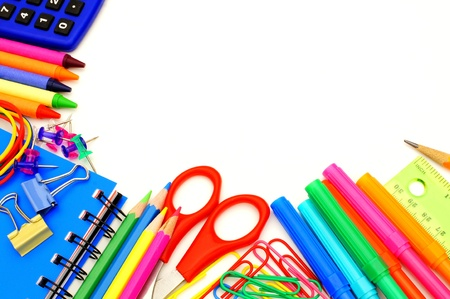 Colorful border of school supplies over a white background Stok Fotoğraf