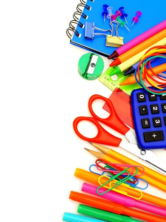 design office: Colorful border of school supplies over a white background Stock Photo