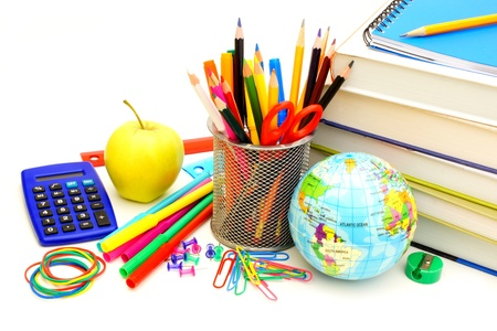 Colorful collection of various school supplies over white  photo