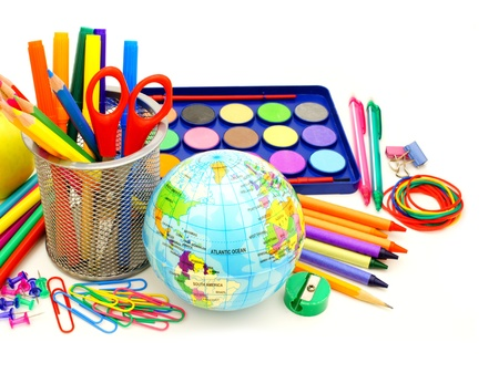 school objects: Colorful collection of various school supplies over white