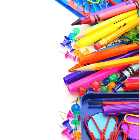 Border of colorful school supplies over white photo