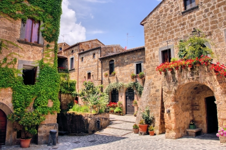 Picturesque corner of a quaint hill town in Italy Фото со стока