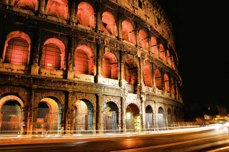 Iconic Colosseum of Rome, light up at night, Italy photo