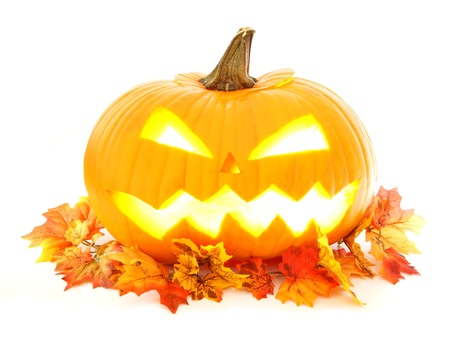 Halloween Jack o Lantern with autumn leaves over white Stock Photo - 21968263