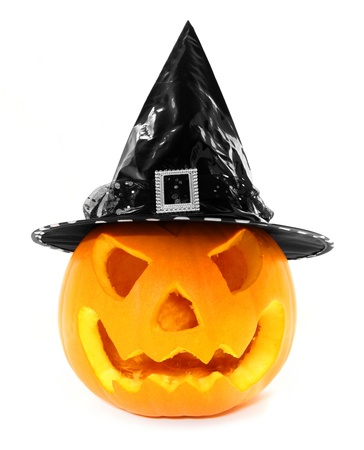 Halloween Jack o Lantern with witch hat isolated on white photo
