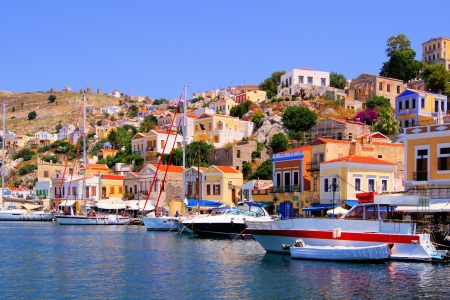 rhodes: Colorful harbor with boats at Symi, Greece Stock Photo