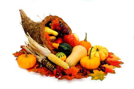 Harvest or Thanksgiving cornucopia filled with vegetables photo