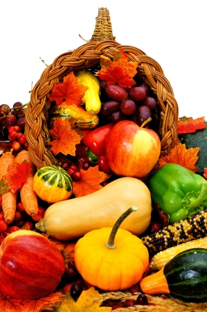 Harvest cornucopia filled with assorted vegetables and fruit Stock Photo