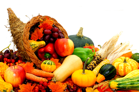 plenty: Harvest cornucopia filled with assorted vegetables and fruit Stock Photo