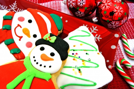 christmas dish: Plate of festive Christmas cookies with baubles and candy canes Stock Photo