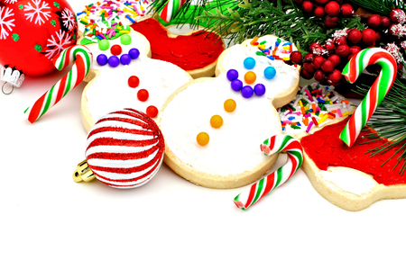 group of christmas baubles: Christmas corner border with cookies, candy, baubles and branches
