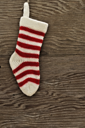 Christmas stocking against a wooden  photo