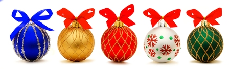 Five unique Christmas bauble decorations with bows isolated on white photo