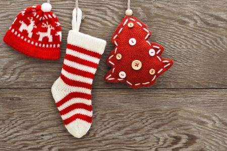 christmas sock: Hanging cloth Christmas decorations on a wooden background Stock Photo