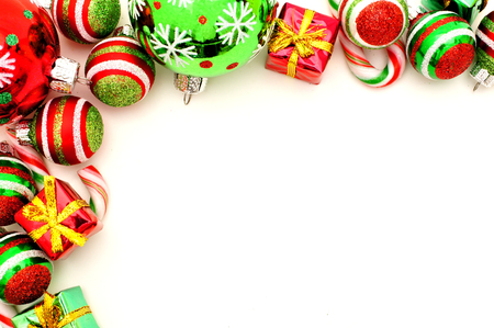 group of christmas baubles: Christmas corner border with baubles, candy and gifts