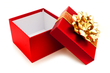 box: Opened red Christmas gift box with gold bow and ribbon