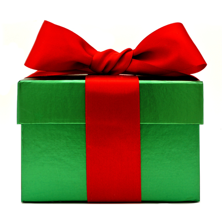 traditional gifts: Green Christmas gift box with red bow isolated on white