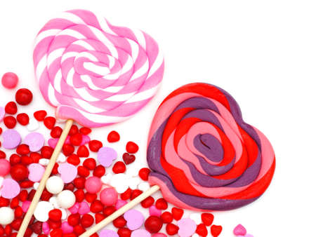 shaped: Heart shaped lollipops and candy corner border Stock Photo