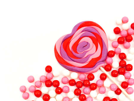 shaped: Heart shaped lollipop and candy corner border