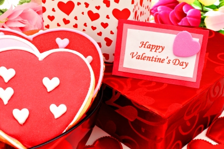 beautiful red tulips close up: Happy Valentines Day card with gift boxes and heart shaped cookies