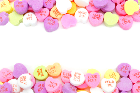 candy hearts: Double edge border of Valentines Day candy hearts over white