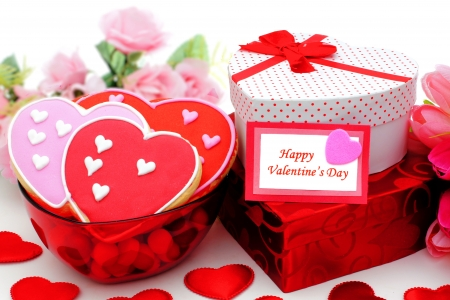 Happy Valentines Day card with gifts and bowl of cookies photo