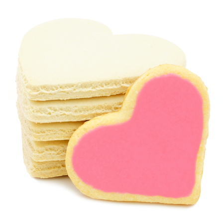 shaped: Stack of heart shaped cookies with pink frosting Stock Photo
