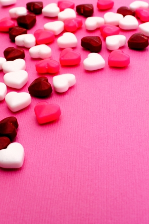 candy border: Valentines Day candy border on a pink textured background