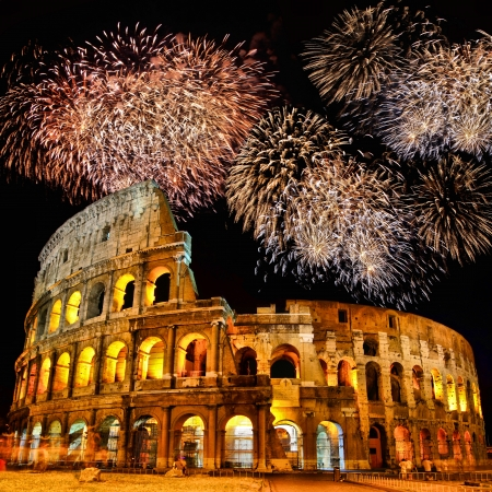 roman amphitheater: Famous Colosseum of Rome at night with fireworks