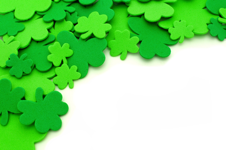 St Patricks Day shamrock corner border over a white background photo