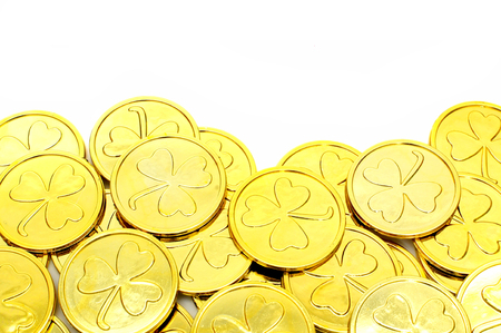 St Patricks Day gold coin border over a white background Stock Photo