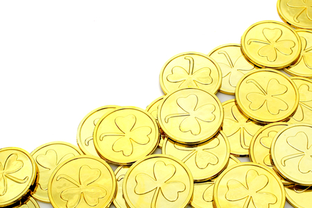 St Patricks Day gold coin corner border over a white background photo