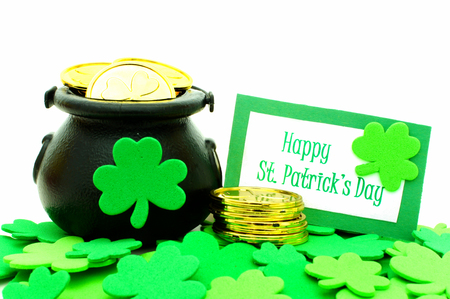 Happy St Patricks Day card with Pot of Gold and shamrocks over white