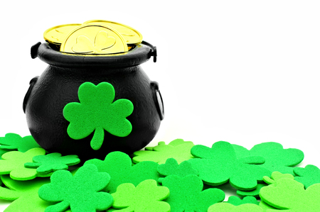 St Patricks Day Pot of Gold and shamrocks over white photo