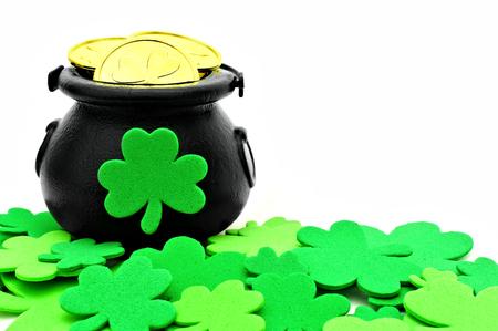 St Patricks Day Pot of Gold and shamrocks over white photo